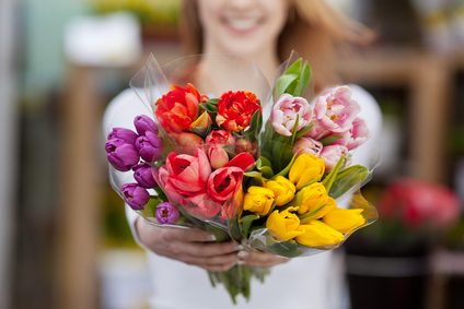 Woman showing a bunch of assorted flowers